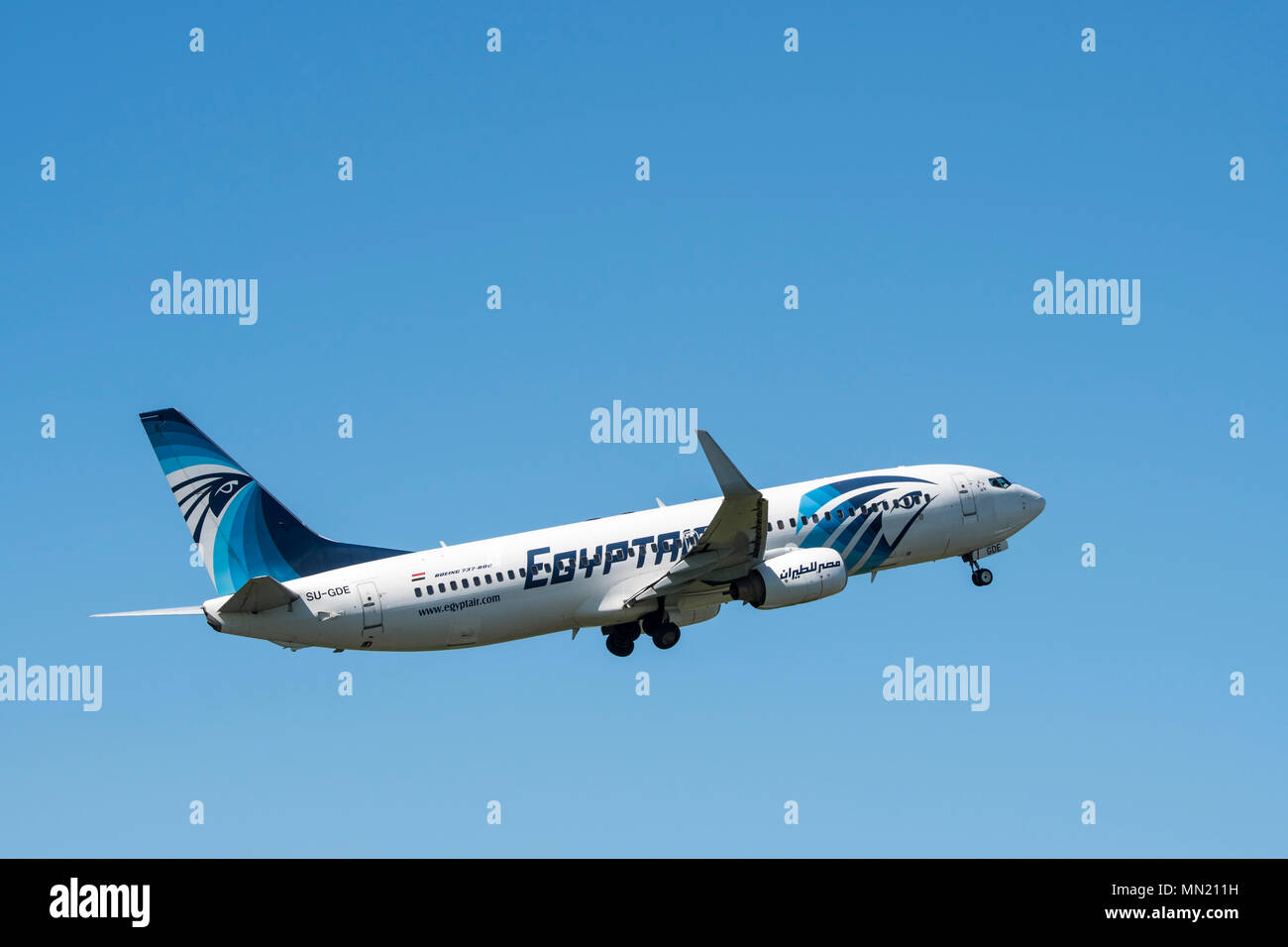 Boeing 737-800, two engine short- to medium-range, narrow-body jet airliner from EgyptAir, Egyptian airline in flight against blue sky - Stock Image