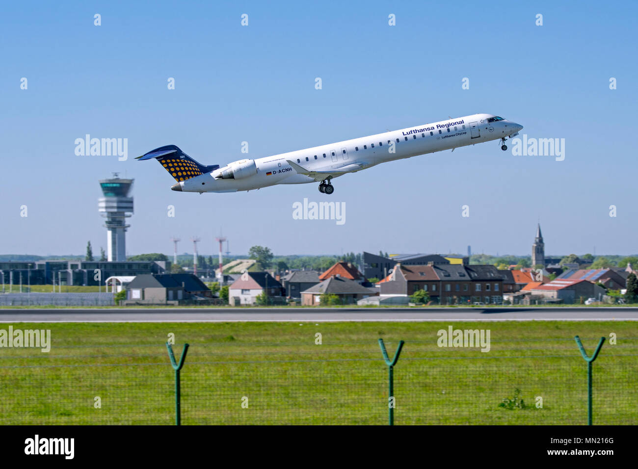 Bombardier CRJ-900LR, regional jet airliner from Lufthansa CityLine taking off from runway at Brussels Airport, Zaventem, Belgium - Stock Image