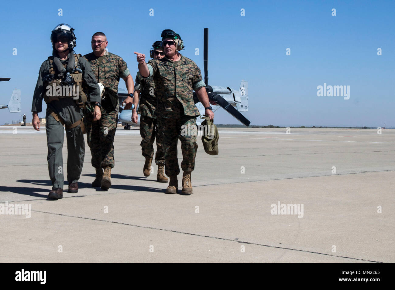 Sergeant Maj. John Elliot, right, the sergeant major of Special Purpose Marine Air-Ground Task Force-Crisis Response-Africa, leads Maj. Gen. Russell A. Sanborn, the commander of Marine Forces Europe and Africa, and his staff off the flight line at Morón Air Base, Spain, Aug. 9 2017. SPMAGTF-CR-AF deployed to conduct limited crisis-response and theater-security operations in Europe and North Africa. (U.S. Marine Corps Photo by 1st Lt. Alexandra Bello) Stock Photo