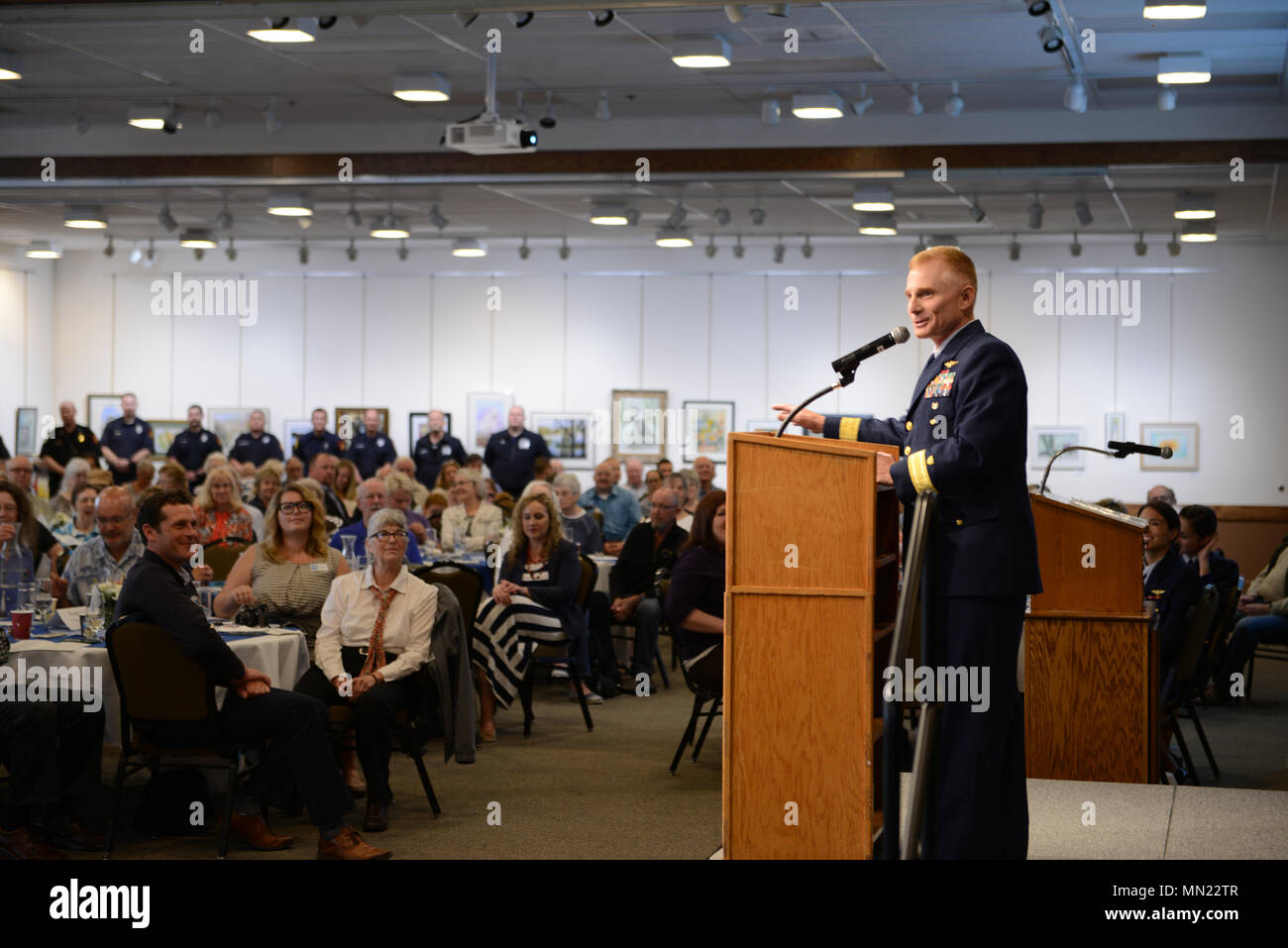 Rear Adm. David Throop, commander, Coast Guard 13th District, speaks at a Coast Guard City designation ceremony held at the Florence, Ore., Events Center, Aug. 16, 2017.    Florence became the third city in Oregon to be named a Coast Guard City and is the 24th in the country.    U.S. Coast Guard photo by Petty Officer 1st Class Levi Read. - Stock Image