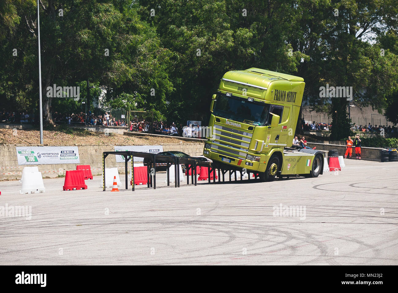 Stuntman of the Franco Medici team they perform on a Scania truck during the Motor Experience, Naples International Auto and Motorcycle exhibition. - Stock Image