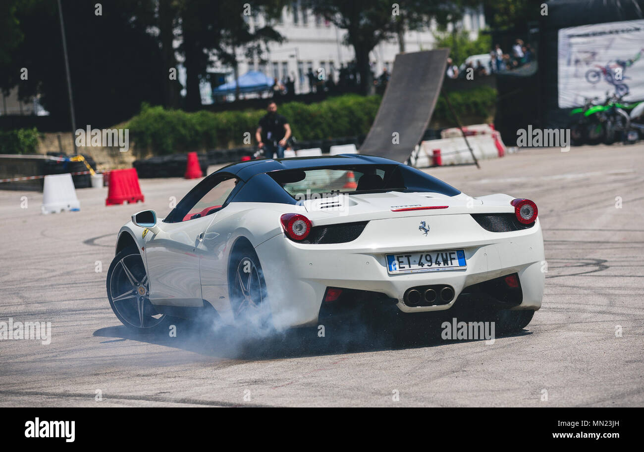 Stuntman of the Franco Medici team they perform on a Ferrari 458 during the Motor Experience, Naples International Auto and Motorcycle exhibition. - Stock Image