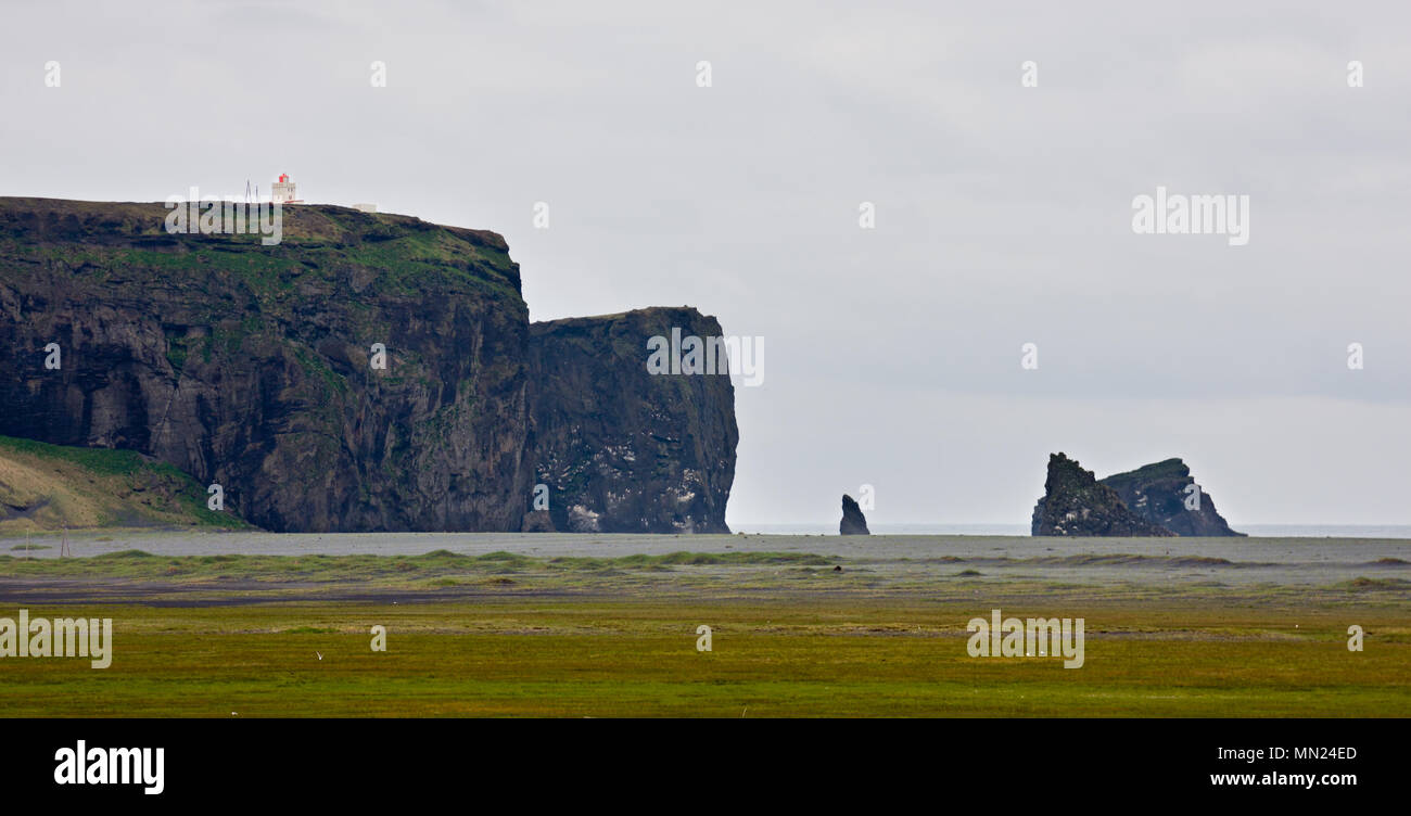 The famous rocks of Dyrholaey seen from the west during gray weather, Iceland. - Stock Image