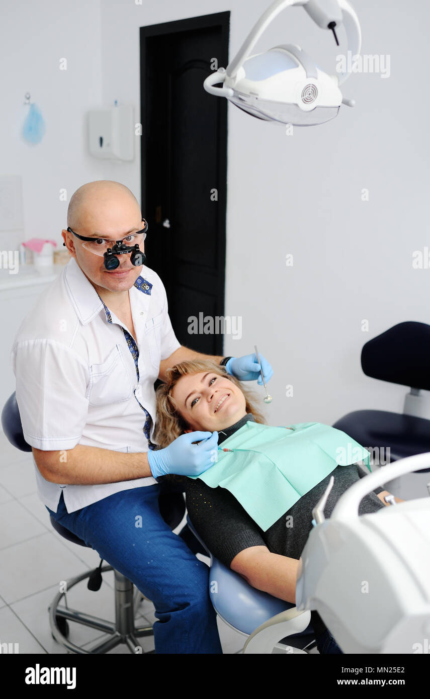 woman on reception at the dentist - Stock Image