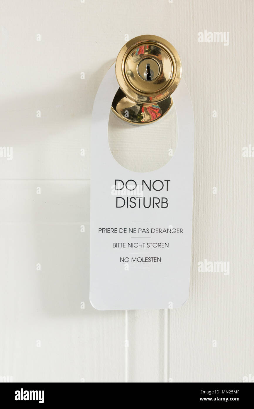 Do Not Disturb sign on hotel bedroom door - Stock Image