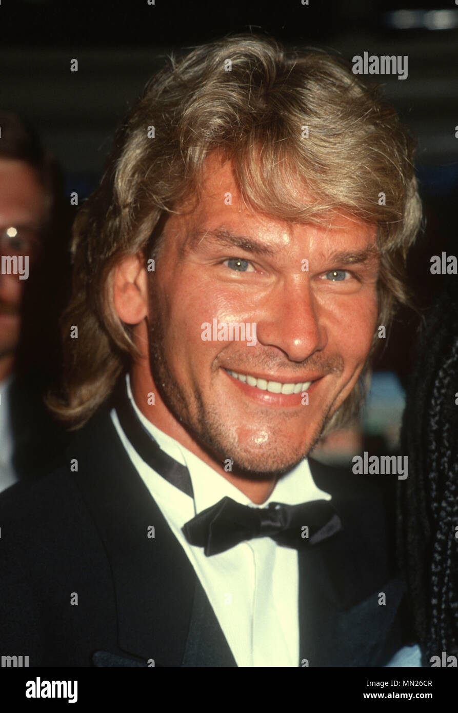 LOS ANGELES, CA - JULY 21:  Actor Patrick Swayze attends black tie dinner honoring Whoopi Goldberg with Children's Choice Award on Crystal Harmony Cruise Ship on July 21, 1990 in Los Angeles, California. Photo by Barry King/Alamy Stock Photo - Stock Image