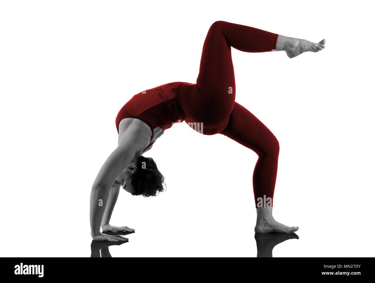 Woman In Urdhva Dhanurasana Yoga Pose on white - Stock Image