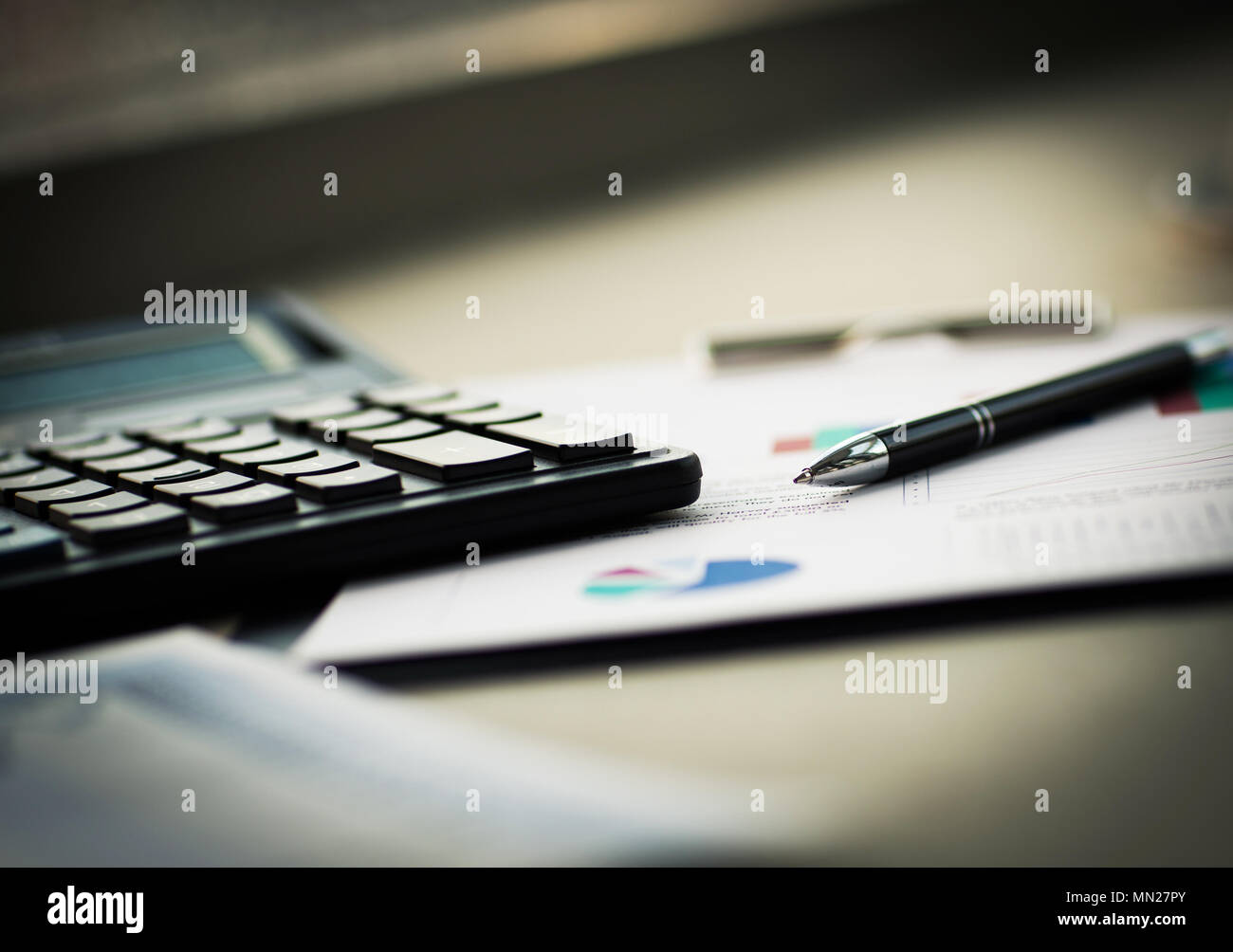 business documents with charts growth, keyboard and pen. - Stock Image