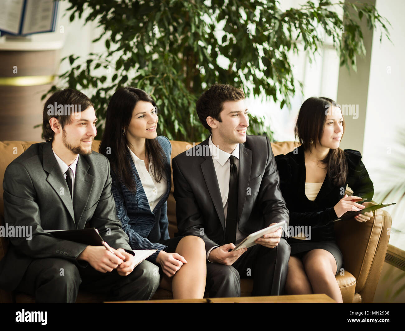 A group of successful businessmen. Look out the window in one direction - Stock Image