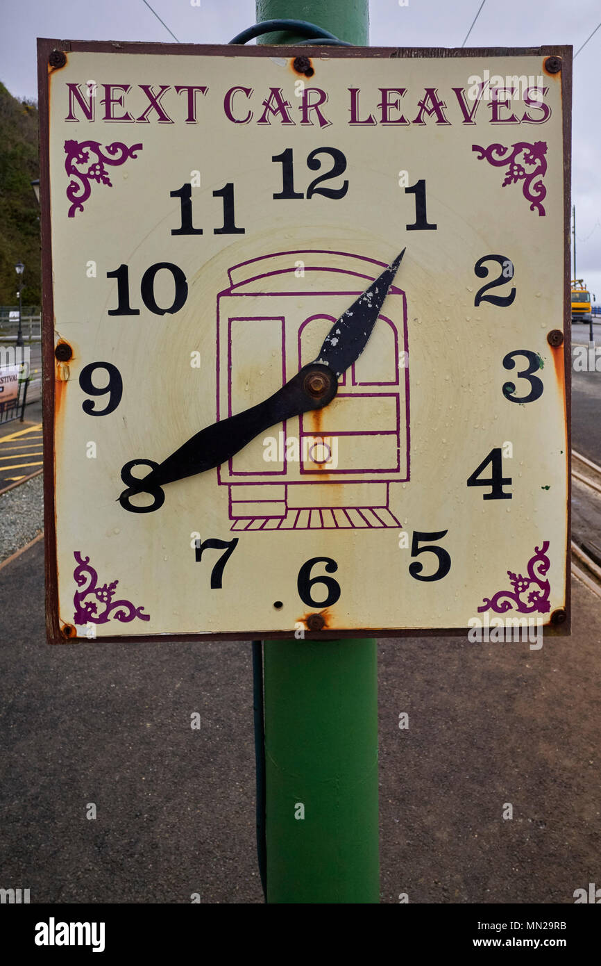 Clockface shows the time of the next electric train to Ramsey from Douglas Stock Photo