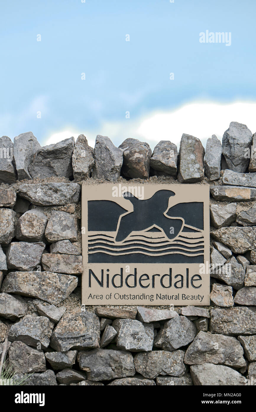 Nidderdale Road / boundary sign built into a dry stone wall - Stock Image