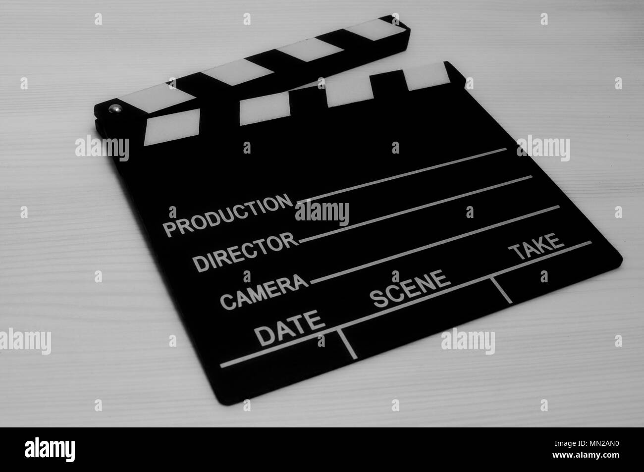 Production film slate black and white on wooden background - Stock Image