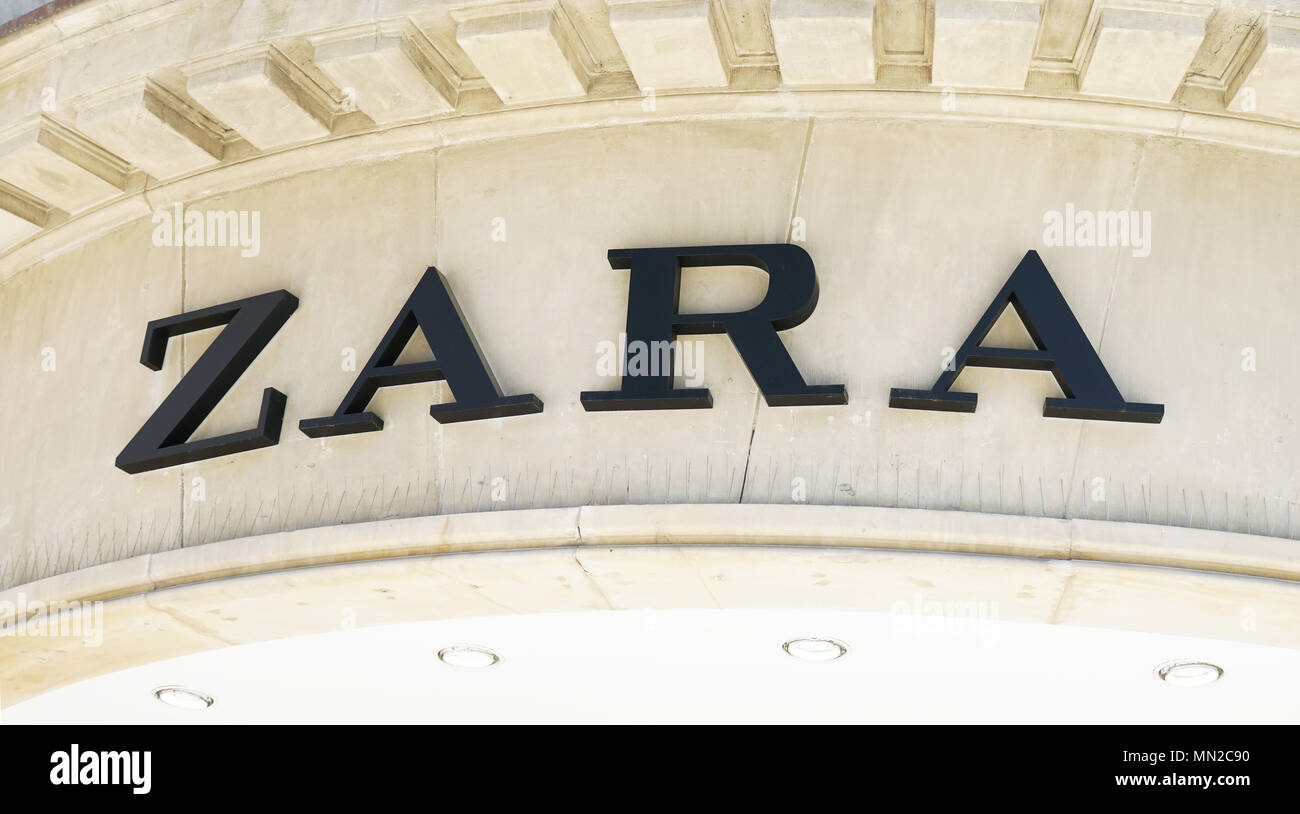 Hannover, Germany - May 7, 2018: Zara logo sign on facade of local shop of Spanish fast fashion retail chain company - Stock Image