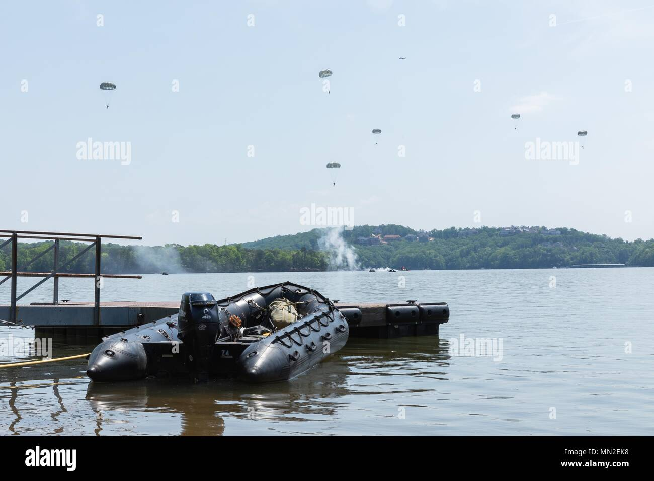 Paratroopers with the 5th Ranger Training Battalion (5th RTB), Camp Merrill, Dahlonega, Georgia, descend to the water during airborne operations at Lake Lanier, GA, May 9, 2018, May 9, 2018. 5th RTB conducted a deliberate airborne operation in order to maintain proficiency in this mission critical task. (U.S. Army photo by Spc. Jesse Coggins/Released). () - Stock Image