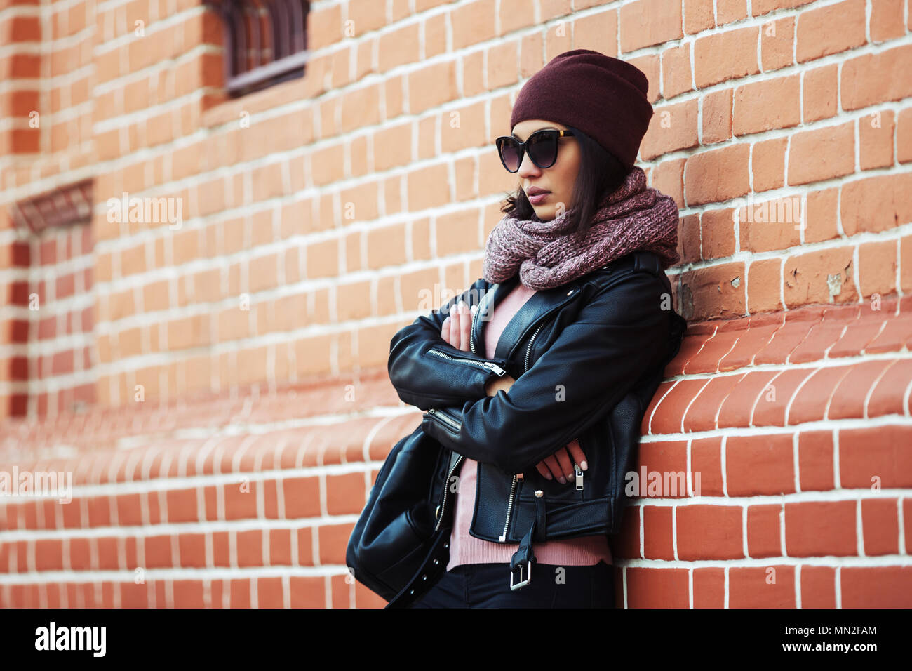 Young Fashion Woman Wearing Sunglasses Scarf And Beanie