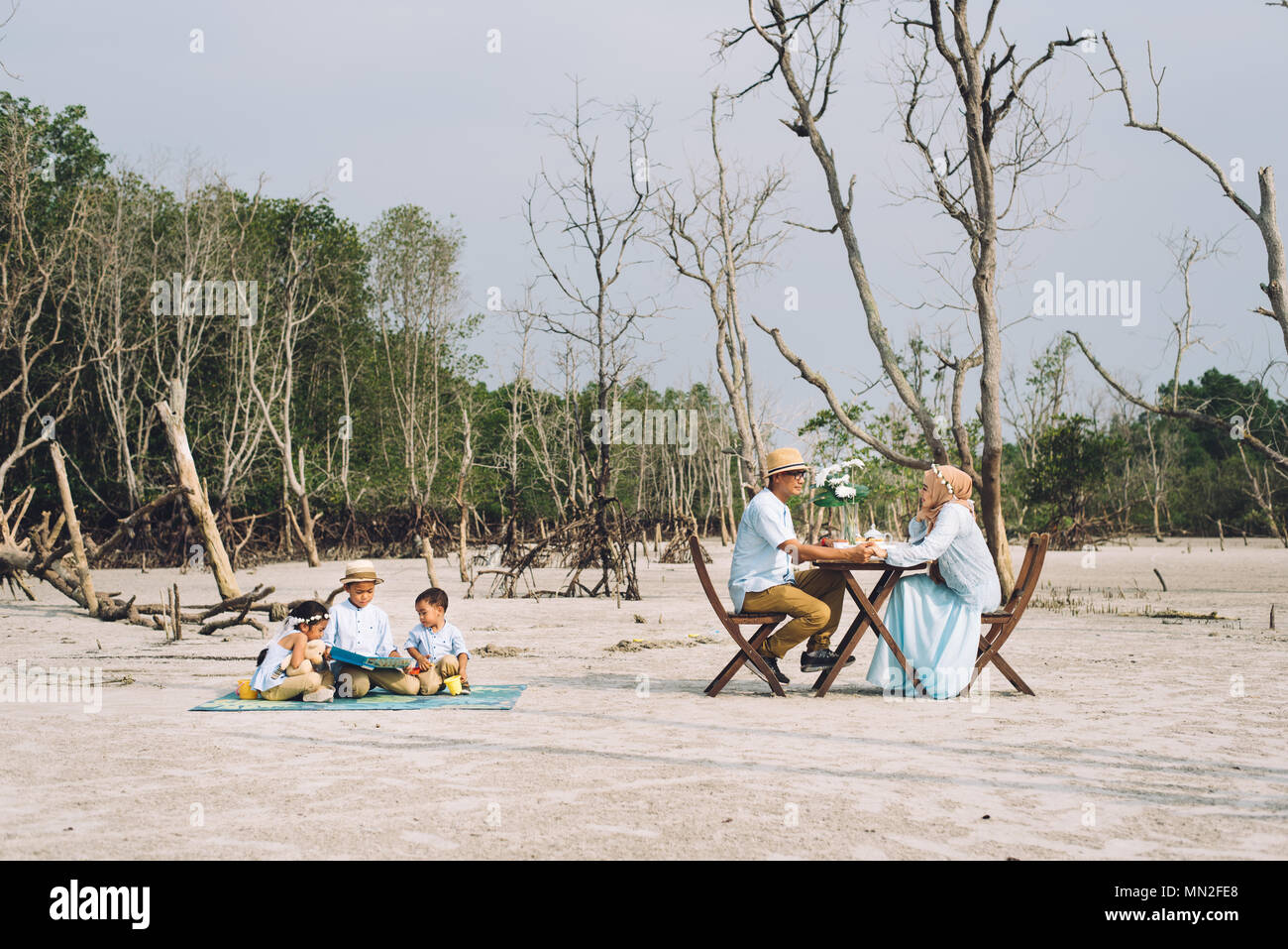 Asian happy family having a picnic. love and happy family concept - Stock Image