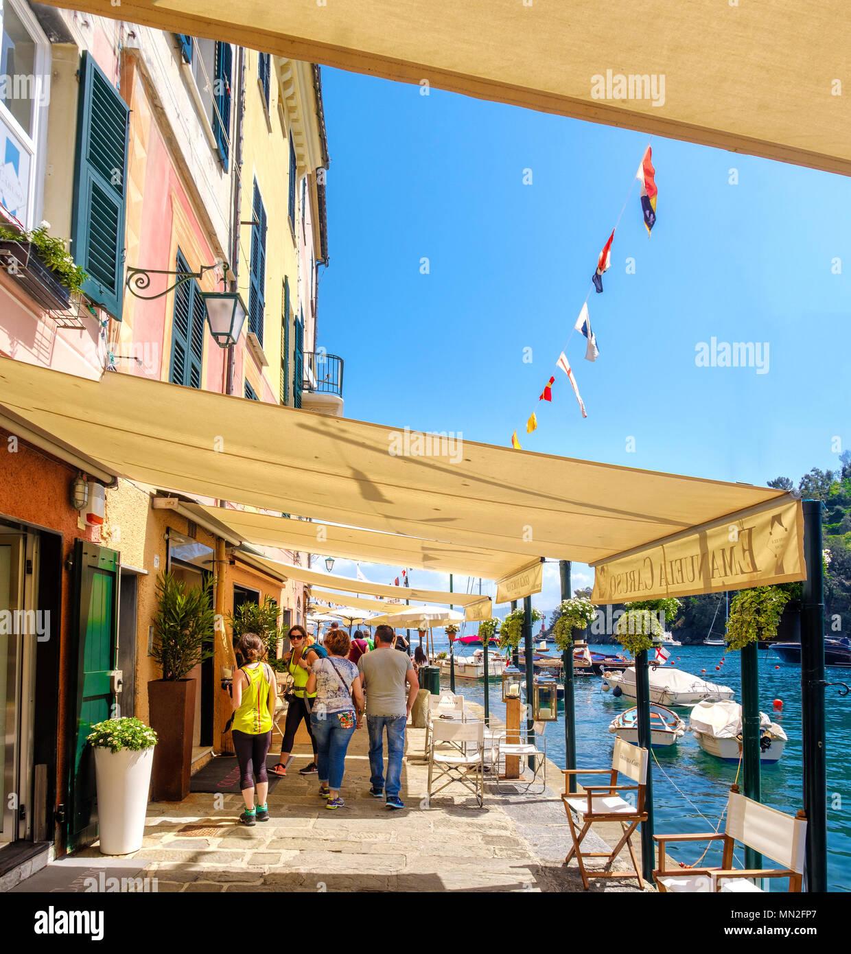 shopping in Portofino Liguria tourists visit Italy shops awning - Stock Image