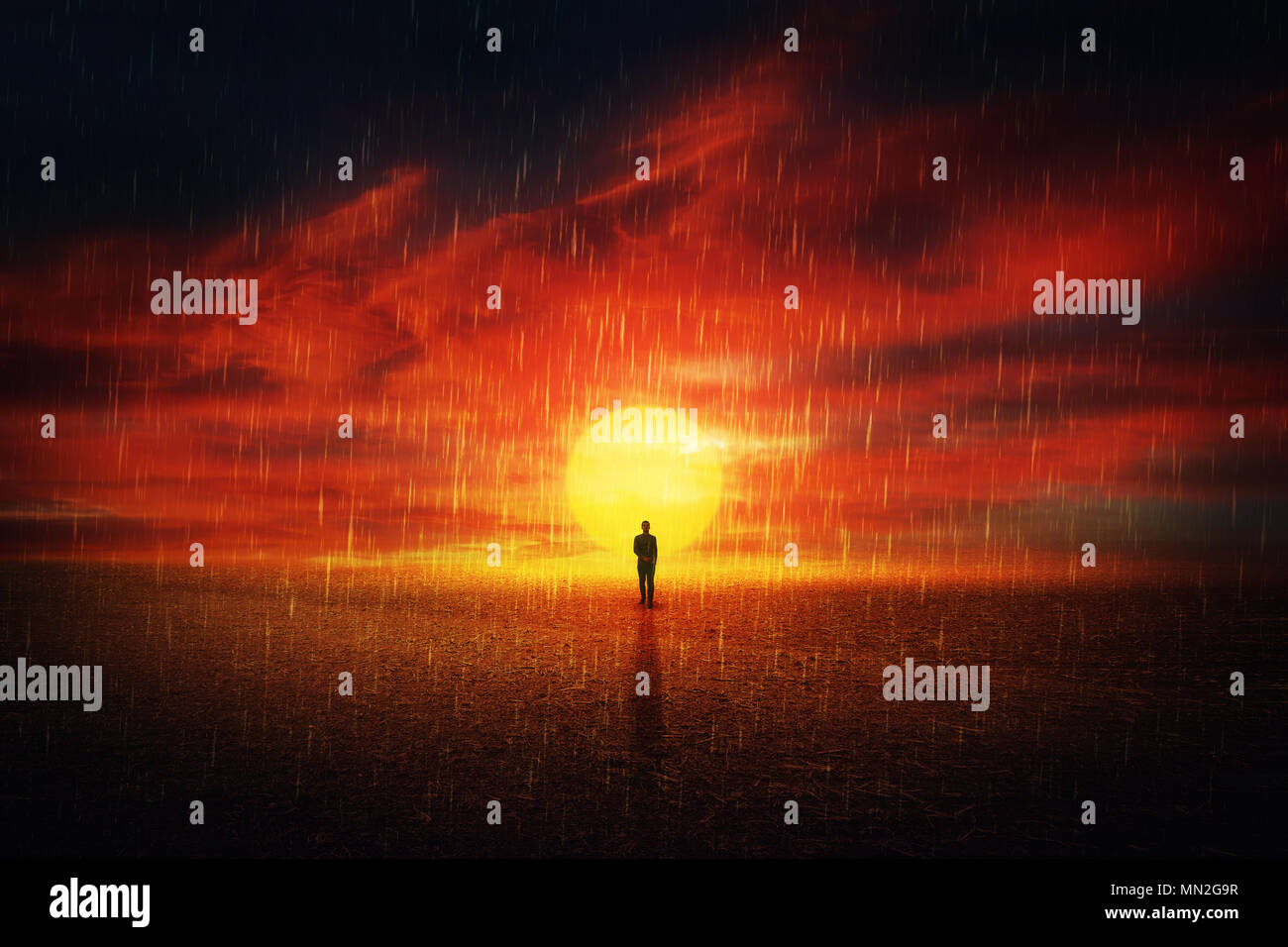 Futuristic scenery view as a man silhouette walking on a dry desert ground over sunset background and the acid rain falling from the sky. Global pollu Stock Photo