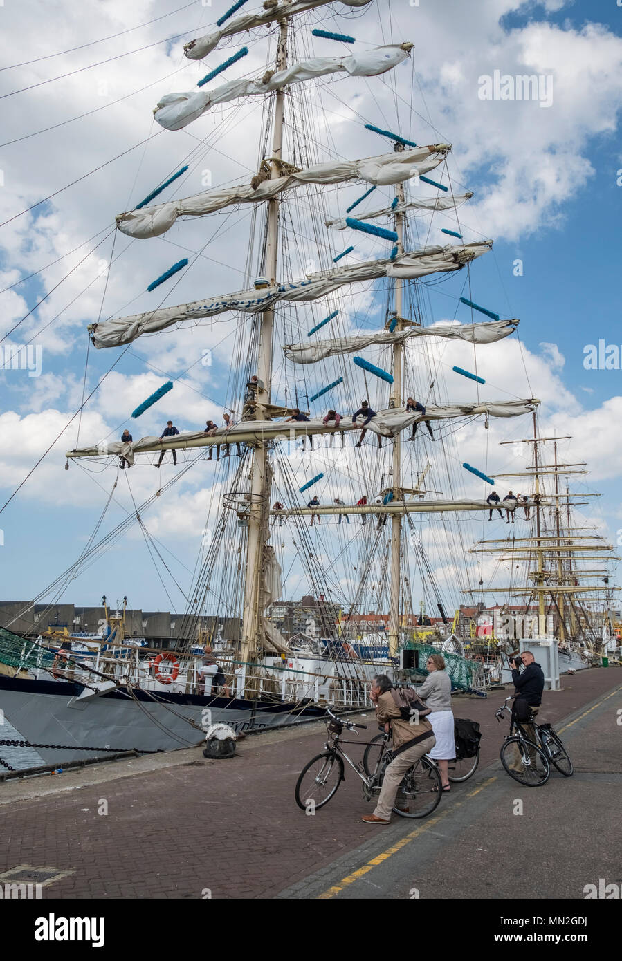 Tall sailing ships Fryderyk Chopin and Sorlandet berthed at Scheveningen harbour, The Hague, Netherlands. - Stock Image