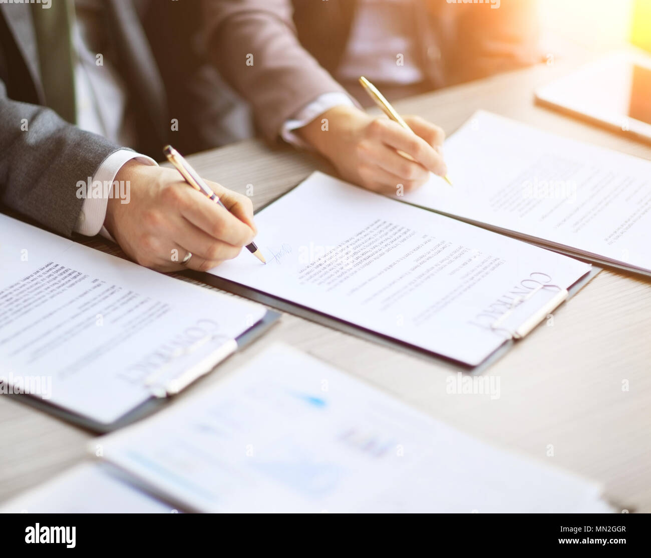 Business young people in the job interview, signed an employment contract with boss in office - Stock Image