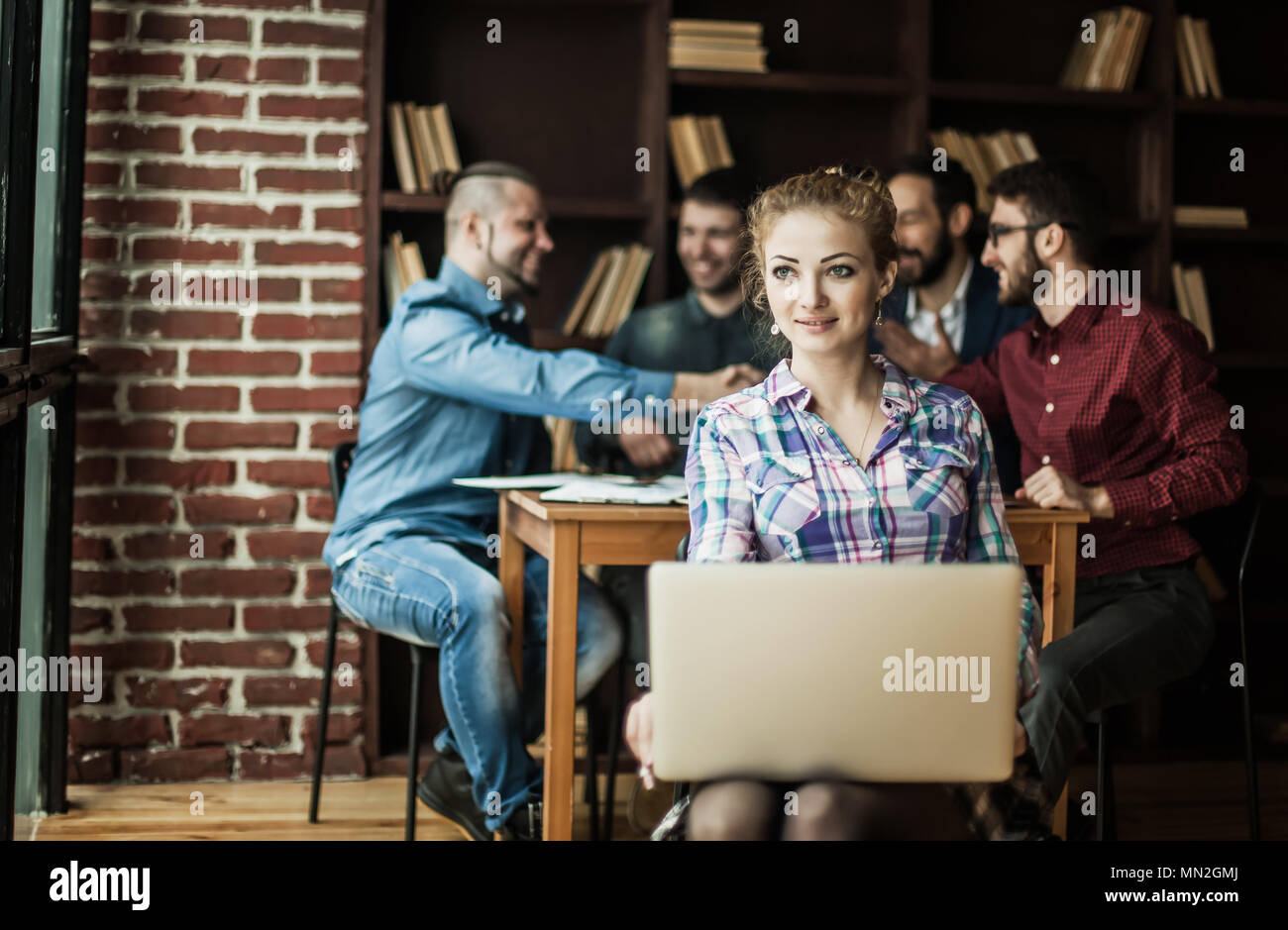financial administrator with laptop on background of business pa - Stock Image