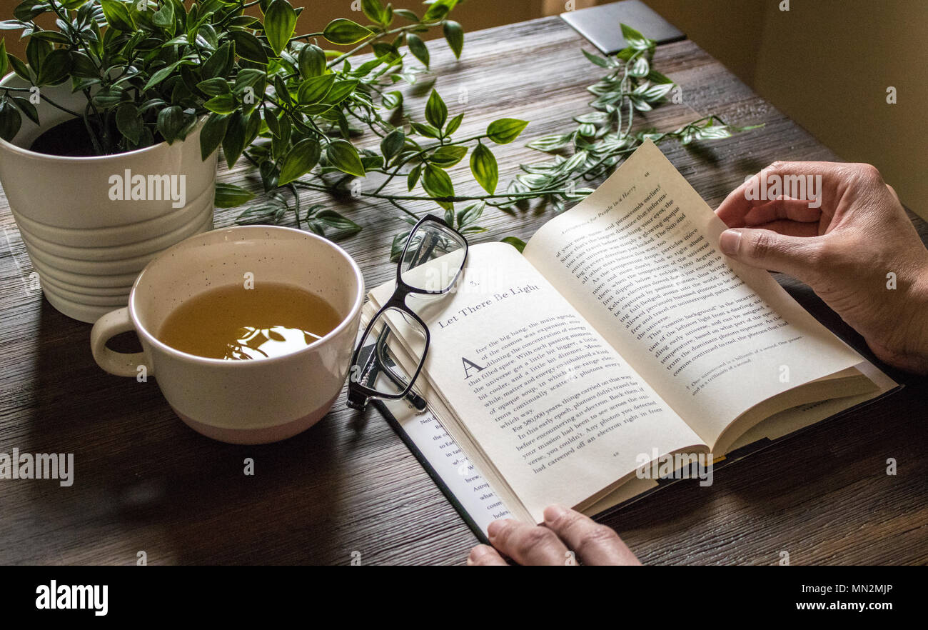 Sunday Morning Meditation - Green Tea and Reading - Let there be light! - Stock Image