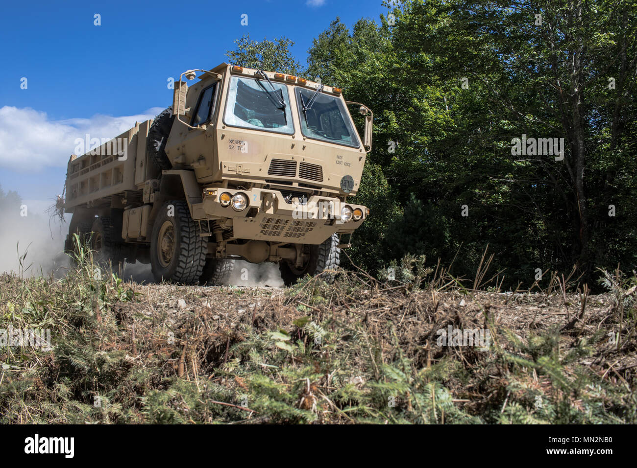 d9df1ce2308 Soldiers from the 185th Engineer Support Company of the Maine Army National  Guard drive their Light Medium Tactical Vehicle in a dump truck variant to  their ...