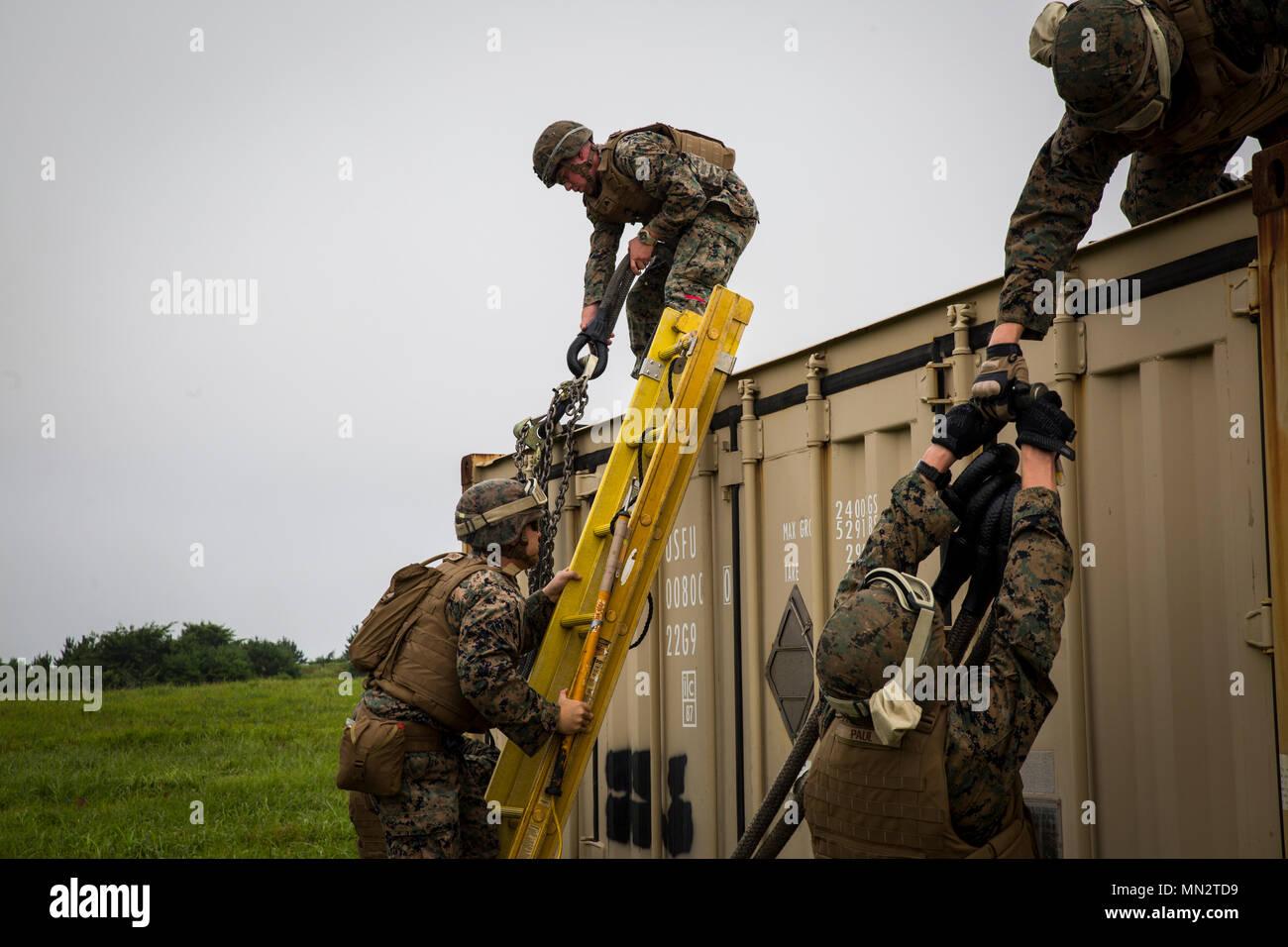 Landing support specialist Marines prepare slings during external