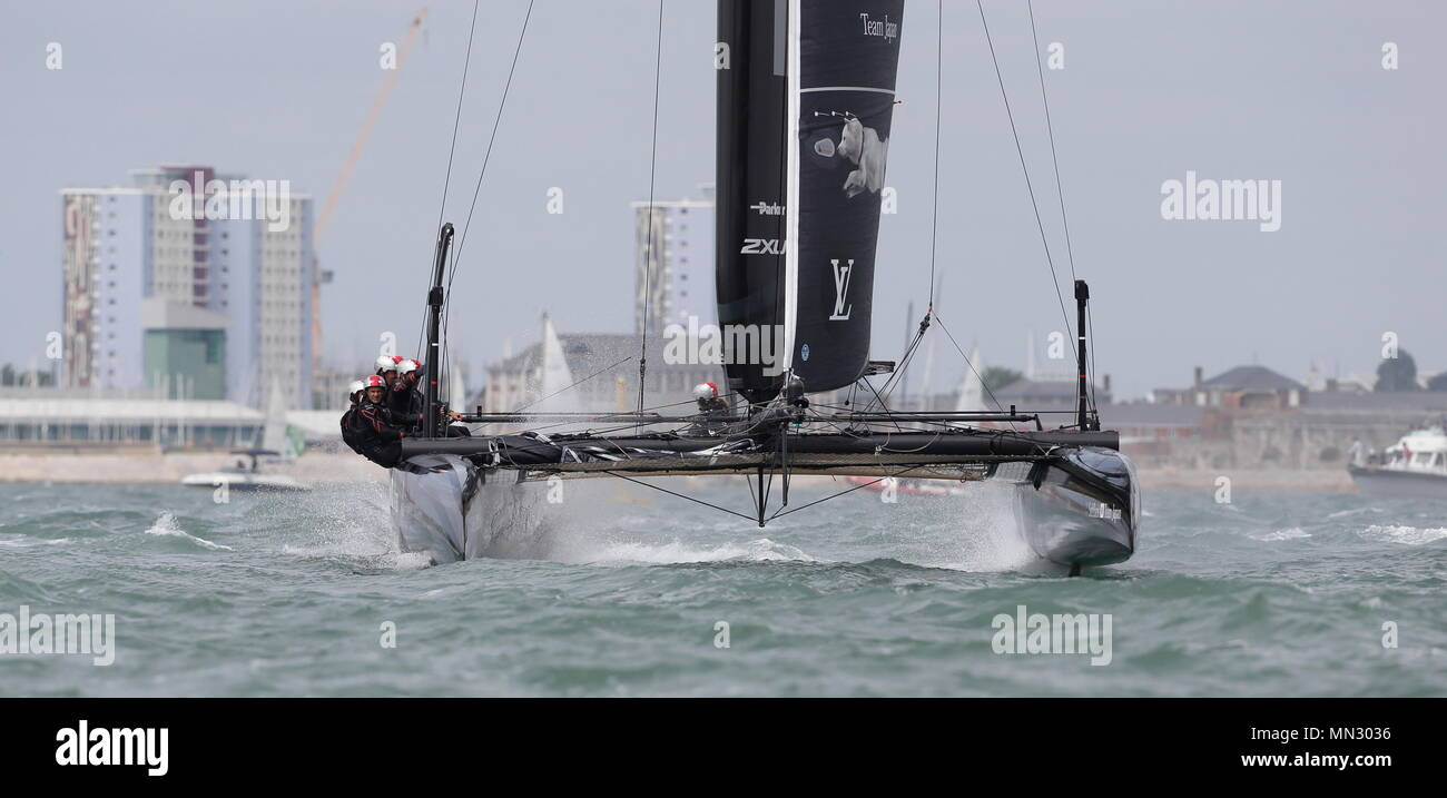 PORTSMOUTH, ENGLAND - JULY 24: The Softbank Team Japan yacht in full race trim on July 24, 2016 in Portsmouth, England. - Stock Image