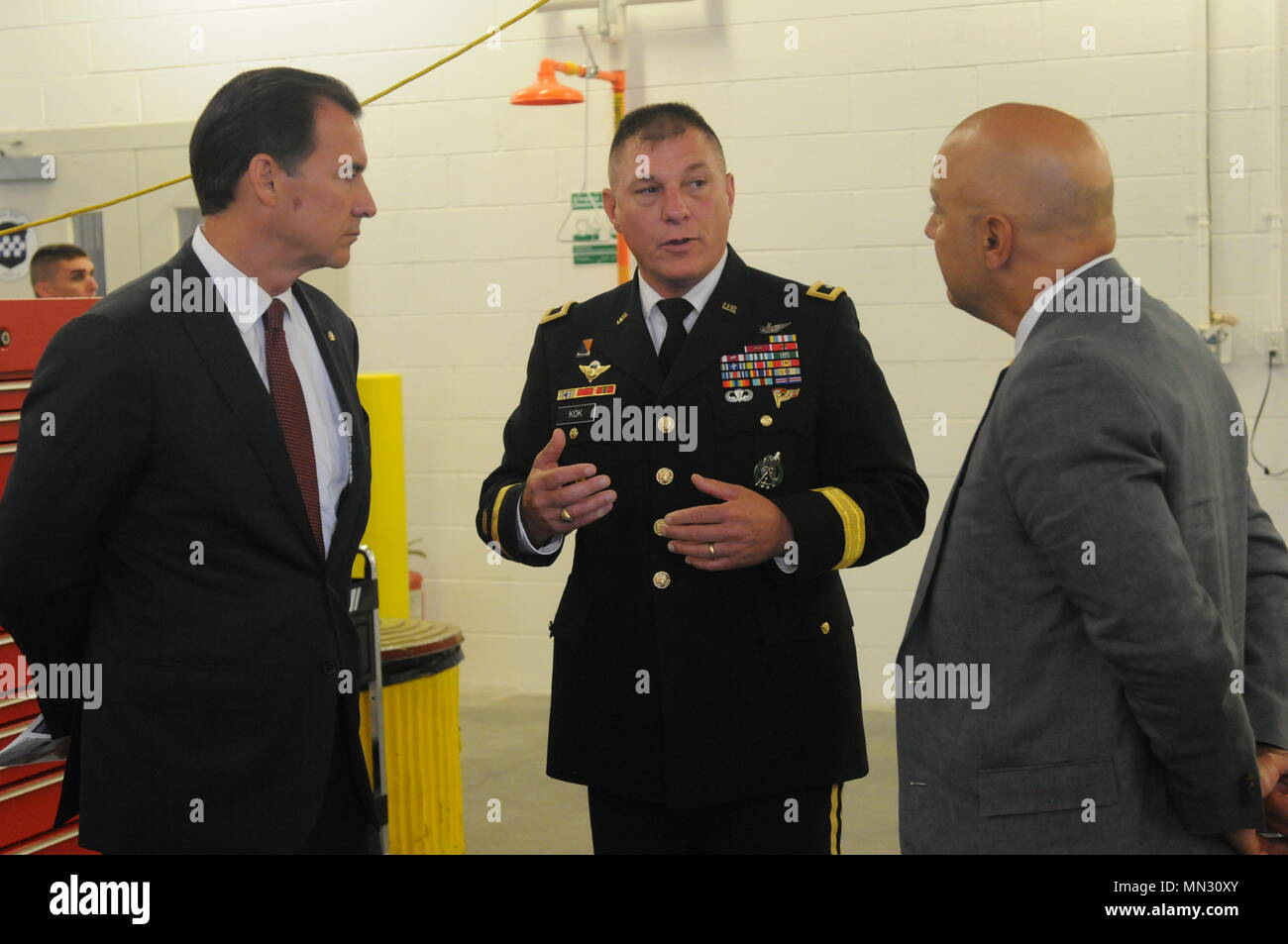 170813-A-FZ134-004  Maj. Gen. Troy D. Kok, commanding general of the U.S. Army Reserve's 99th Regional Support Command, speaks with U.S. Congressman Thomas R. Suozzi and New York City Council Member, 19th District, Queens, Paul A. Vallone at the ribbon-cutting ceremony Aug. 17 for the revitalized AMSA/OMS (Area Maintenance Support Activity/Organizational Maintenance Shop) in Fort Totten. The center underwent a $12.6 million full-facility revitalization, allowing technicians to perform in an up-to-date facility to meet readiness standards as well as train military unit mechanics as needed so th Stock Photo