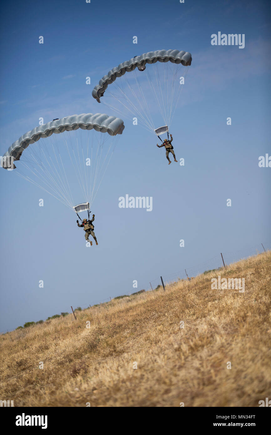 Spanish paratroopers descend to the ground during Operation Death