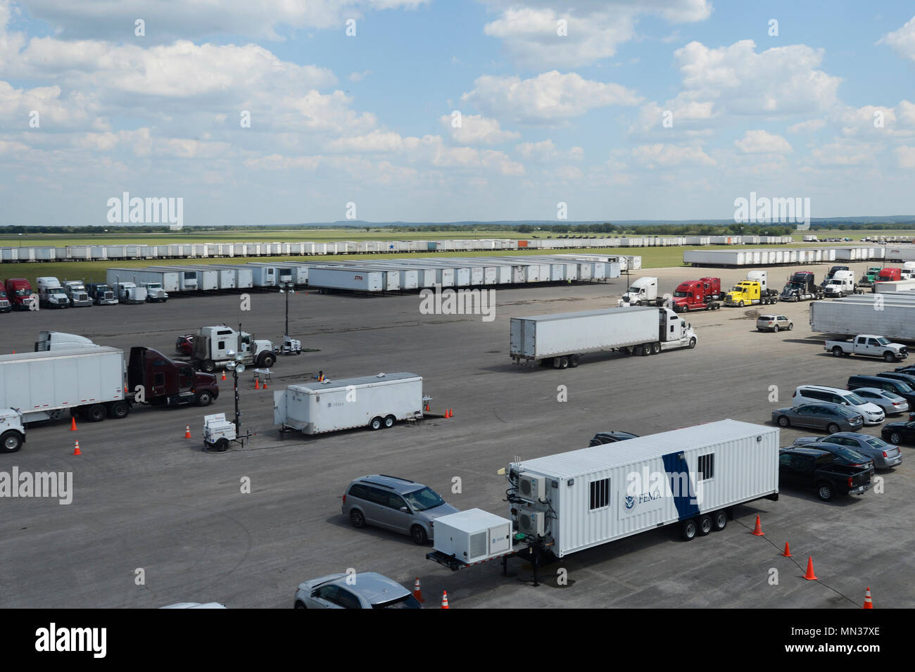Supplies loaded into trailers are staged for Hurricane Harvey disaster-relief efforts at JBSA Randolph auxiliary airfield, Seguin, Texas, August 30, 2017. The category-4 hurricane, with wind speeds of 130 mph, made landfall August 25, 2017.  Days after the hurricane reached Texas, more than 50 inches of rain flooded the coastal region. (U.S. Air Force Photo by Tech. Sgt. Chad Chisholm/Released) Stock Photo