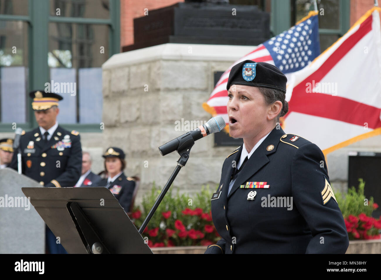 The Alabama National Guard's 151st Army Band performs at the dedication of the Rainbow Soldier ceremony, memorializing the Alabama National Guard's 167th Infantry Regiment's role in World War I, in Montgomery, Alabama, Aug. 28, 2017. (Photo by Army Sgt. William Frye.) - Stock Image