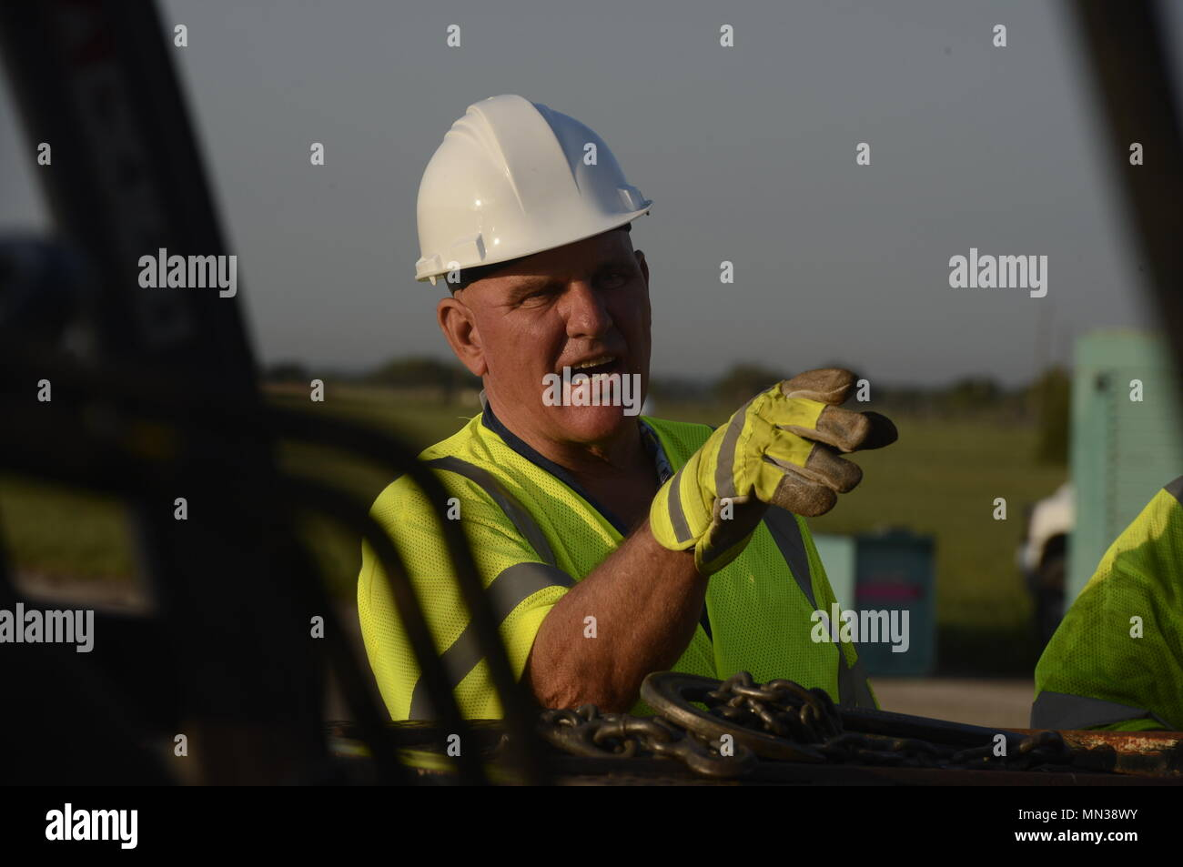 Jake Jecmenek, contractor, directs a forklift operator to position a Federal Emergency Management Agency generator on a rollback truck that will be used to support Hurricane Harvey relief efforts, at JBSA Randolph auxiliary airfield, Seguin, Texas, August 31, 2017. The category-4 hurricane, with wind speeds of 130 mph, made landfall August 25, 2017.  Days after the hurricane reached Texas, more than 50 inches of rain flooded the coastal region. (U.S. Air Force Photo by Tech. Sgt. Chad Chisholm/Released) Stock Photo