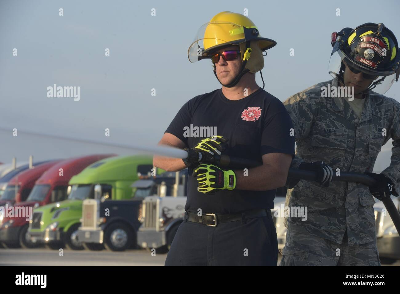 Jeff Duncan, Red River Army Depot firefighter/EMT, and Airman 1st Class Evan Nares, 502nd Civil Engineering Squadron head driver operator, conducts an operation check on an attack line for a state of readiness during the Hurricane Harvey relief efforts, at JBSA Randolph auxiliary airfield, Seguin, Texas, September 2, 2017. The category-4 hurricane, with wind speeds of 130 mph, made landfall August 25, 2017.  Days after the hurricane reached Texas, more than 50 inches of rain flooded the coastal region. (U.S. Air Force Photo by Tech. Sgt. Chad Chisholm/Released) Stock Photo