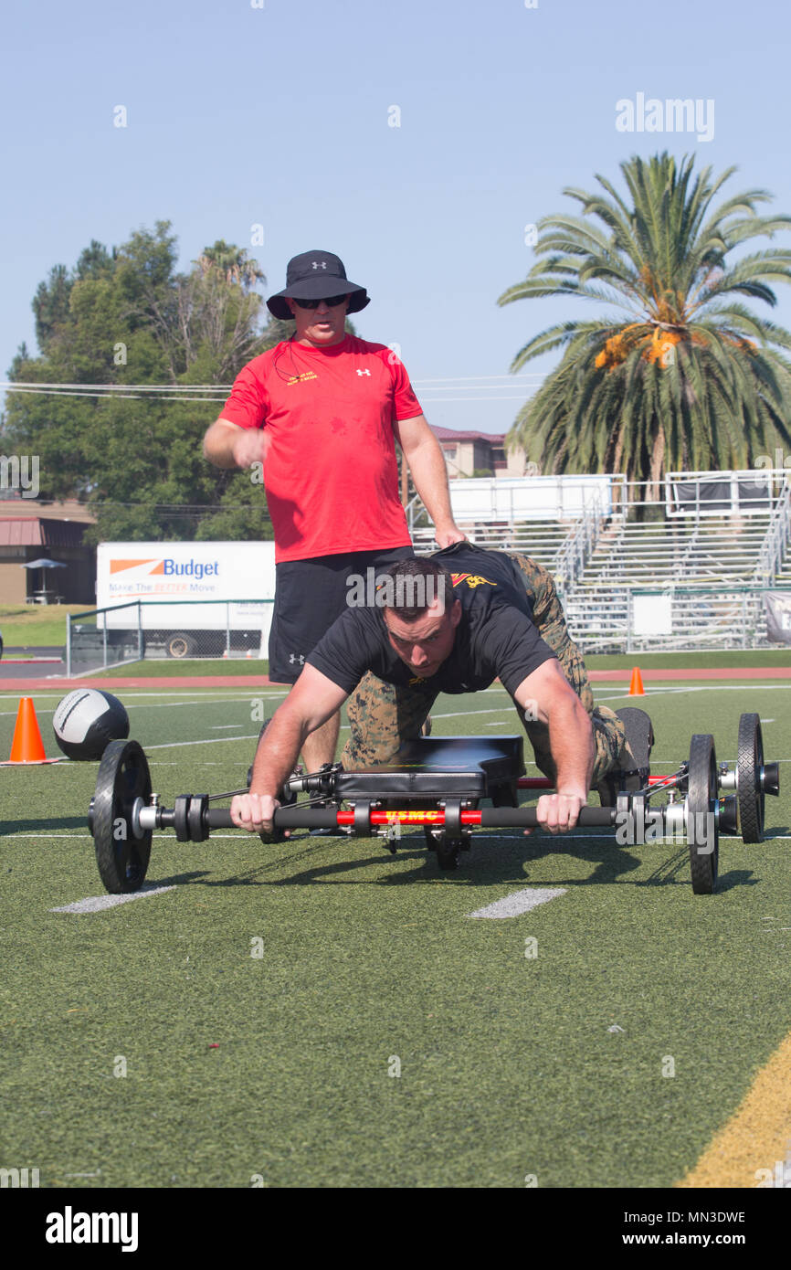 436765494 ... training squadron, Marine Corps Communication Electronics School,  performs a 25-yard movement on the Frog Fitness Frog Total Body Resistance  Trainer ...