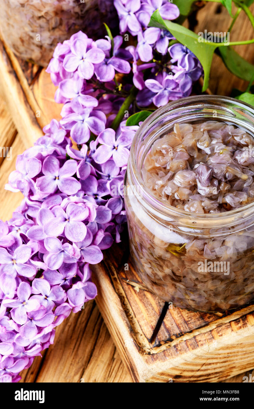 Healing jam from the flowers of spring lilacs.Healing syrup - Stock Image