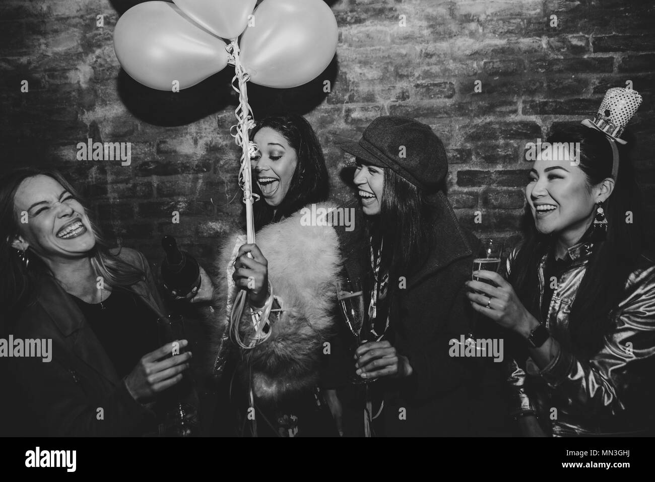Group of girls celebrating and having fun the club. Concept about women night out - Stock Image