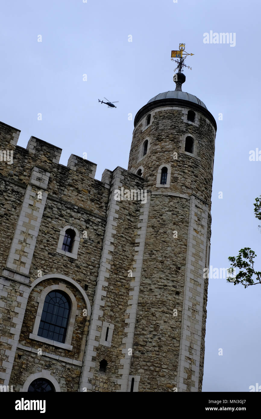 Helicopter flying above The Tower of London UK - Stock Image