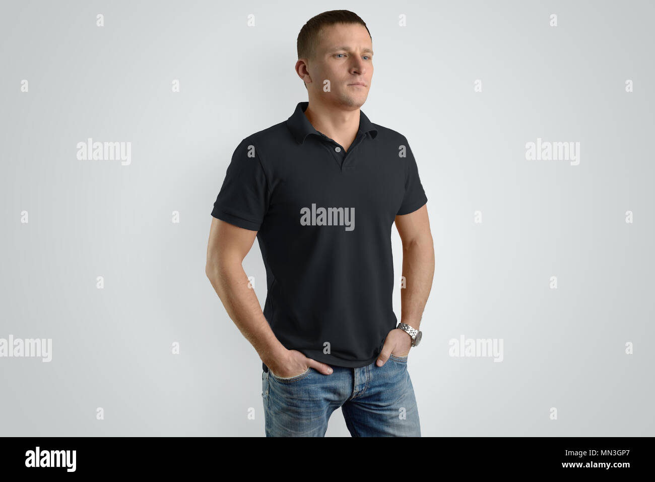 520cfc41cc0a Front Mockup black polo shirt on a guy for an example design. Man isolated  on