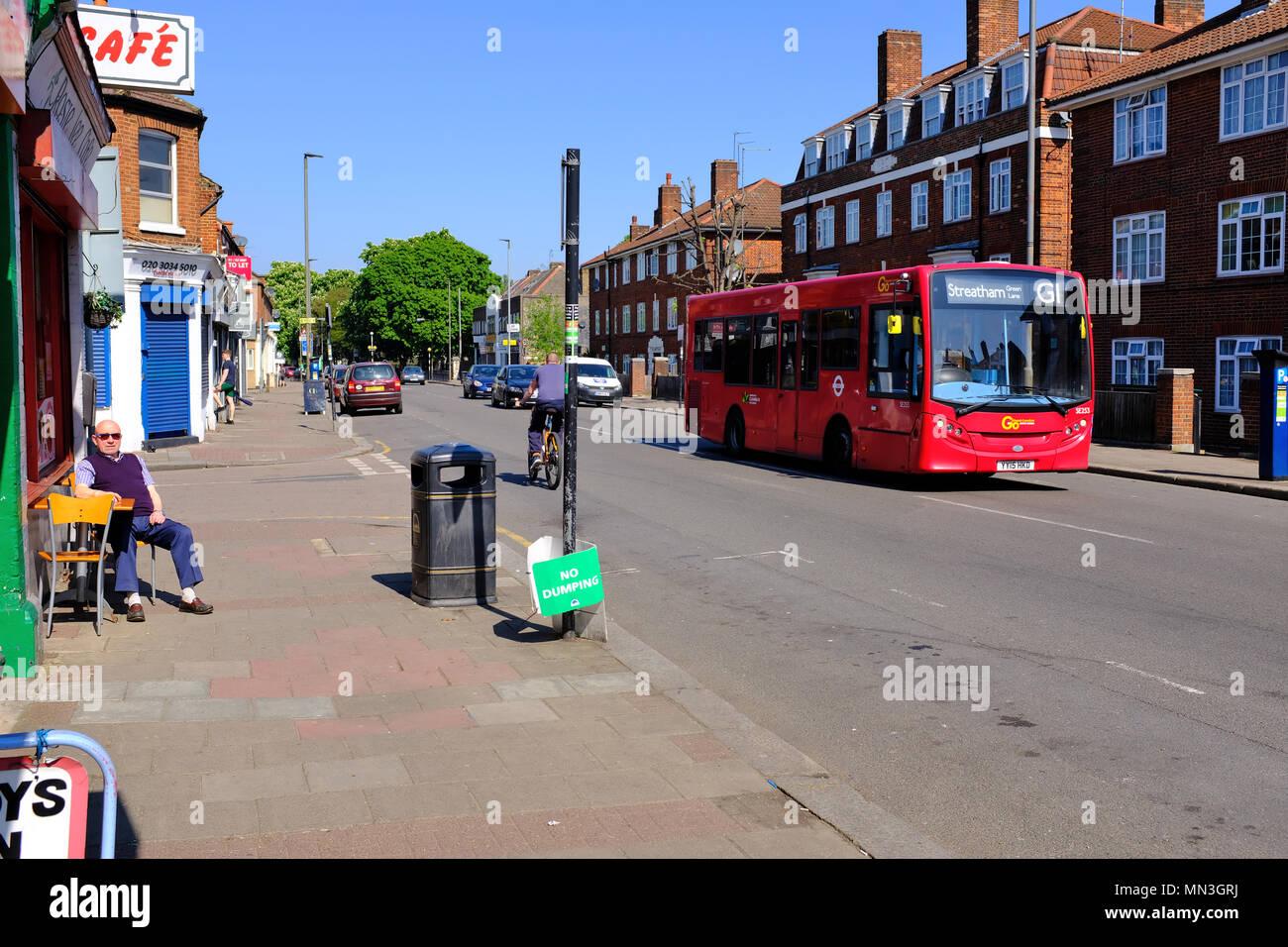 Red bus on Garratt Lane Tooting London SW17 - Stock Image