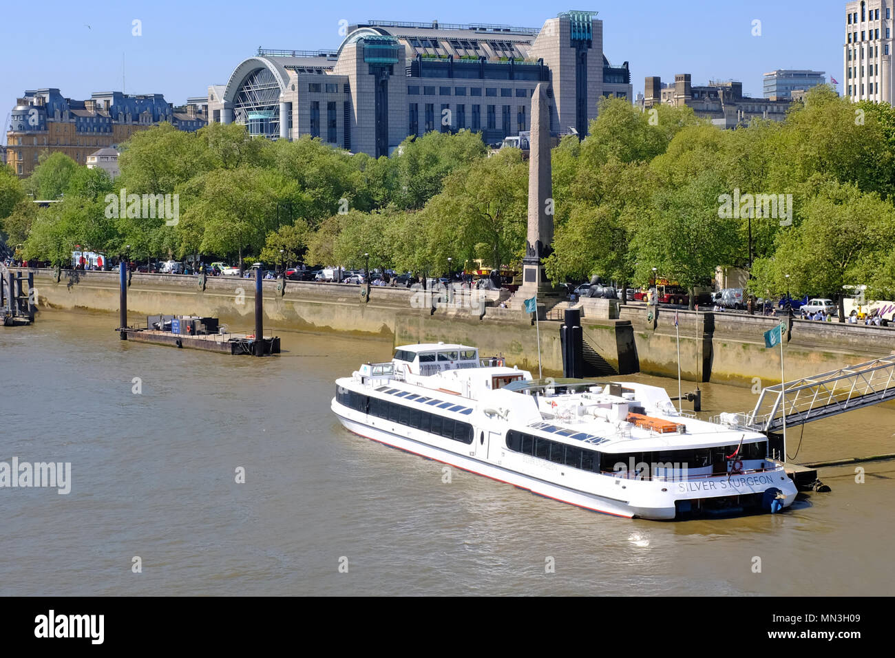 View from Waterloo Bridge of a river cruise boat  - London - Stock Image