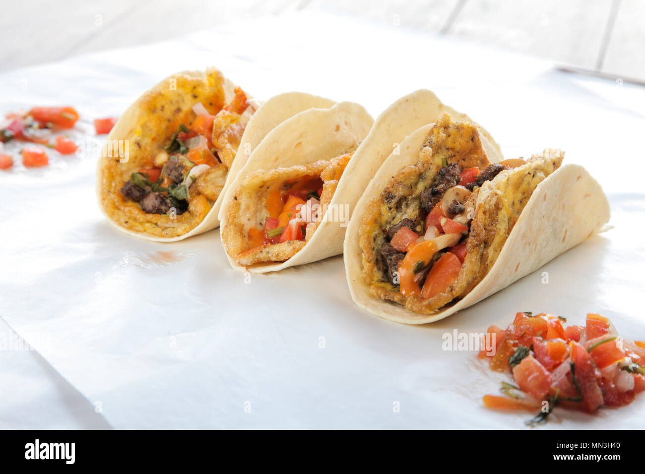 Breakfast tacos with egg omelette cheese mushroom and meat - Stock Image