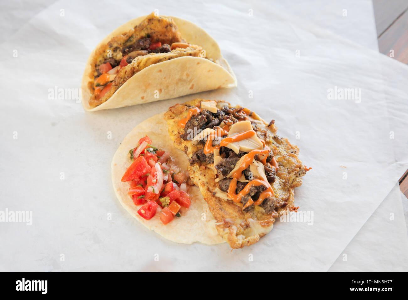 Beef steak mushroom omelette taco tortilla wrap breakfast - Stock Image