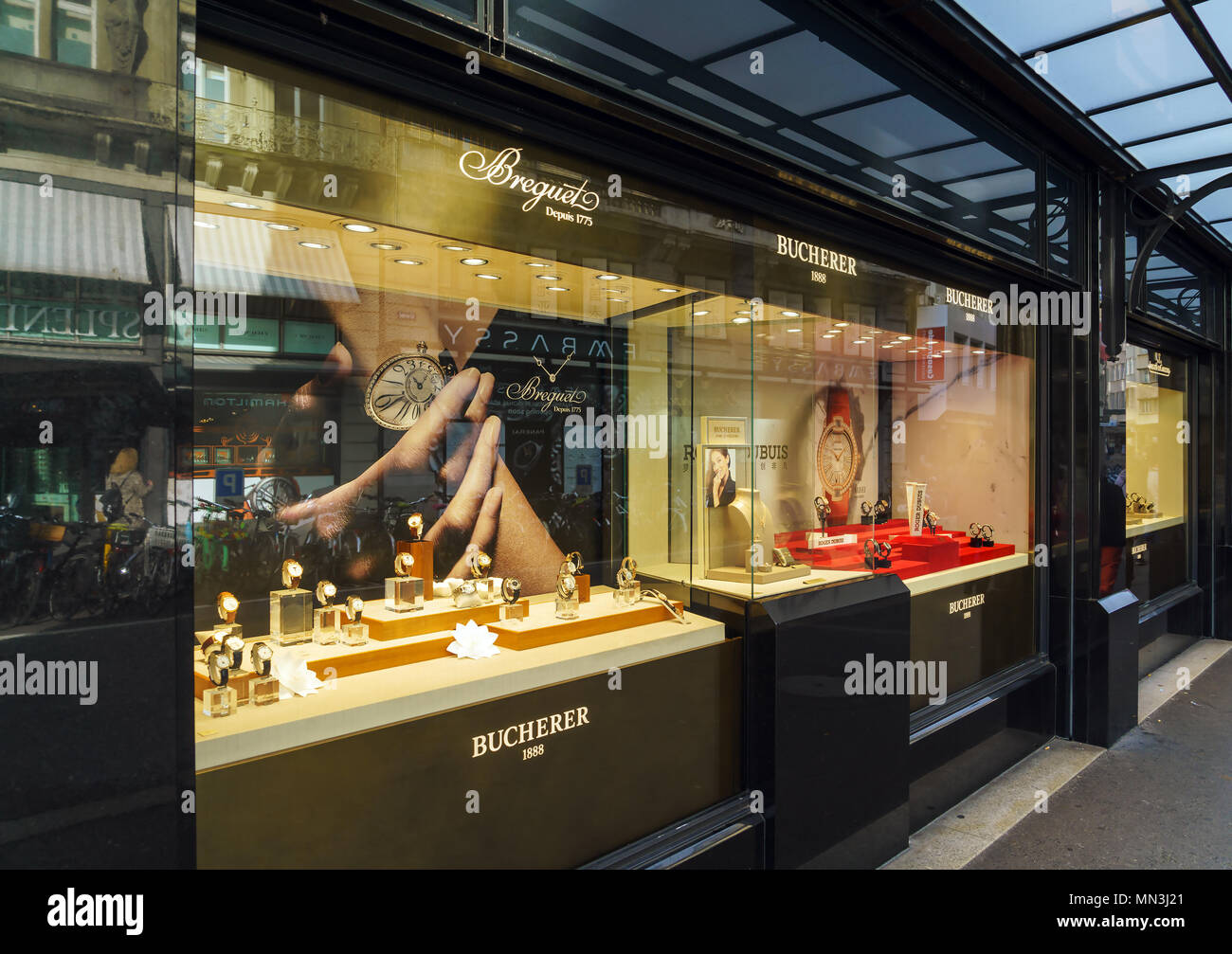 Lucerne, Switzerland - October 19, 2017: Showcases with wristwatches of expensive watch brands Breguet and Bucherer - Stock Image