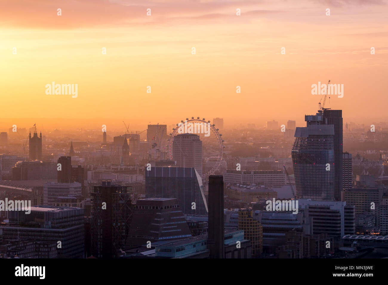 London city skyline.  A cityscape at sunset.  Despite the dreamy look, London suffers from high levels of air pollution, affecting the health of many. - Stock Image