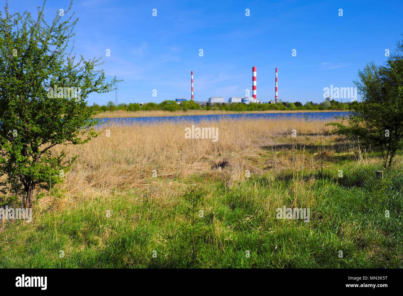 Warsaw, Mazovia / Poland - 2018/04/12: Siekierki Power and Heat Plant in Czerniakow quarter of Warsaw neighboring Czerniakowskie Lake nature reserve Stock Photo
