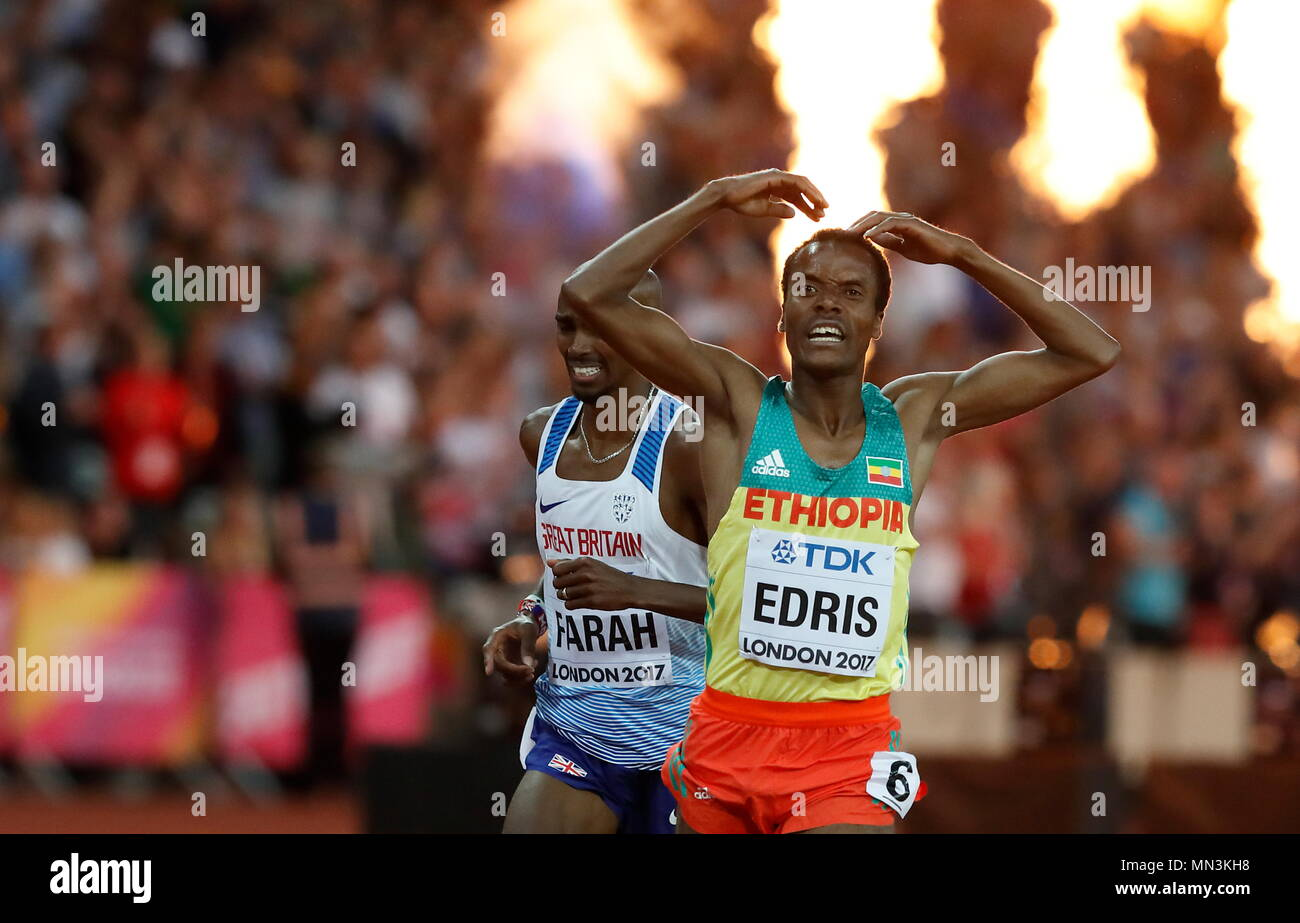 LONDON, ENGLAND - AUGUST 12: Muktar Edris of Ethiopia celebrates after the winning the Men's 5000 Metres Final passing Mo Farrah during day nine of the 16th IAAF World Athletics Championships London 2017 at The London Stadium on August 12, 2017 in London, United Kingdom --- Image by © Paul Cunningham - Stock Image