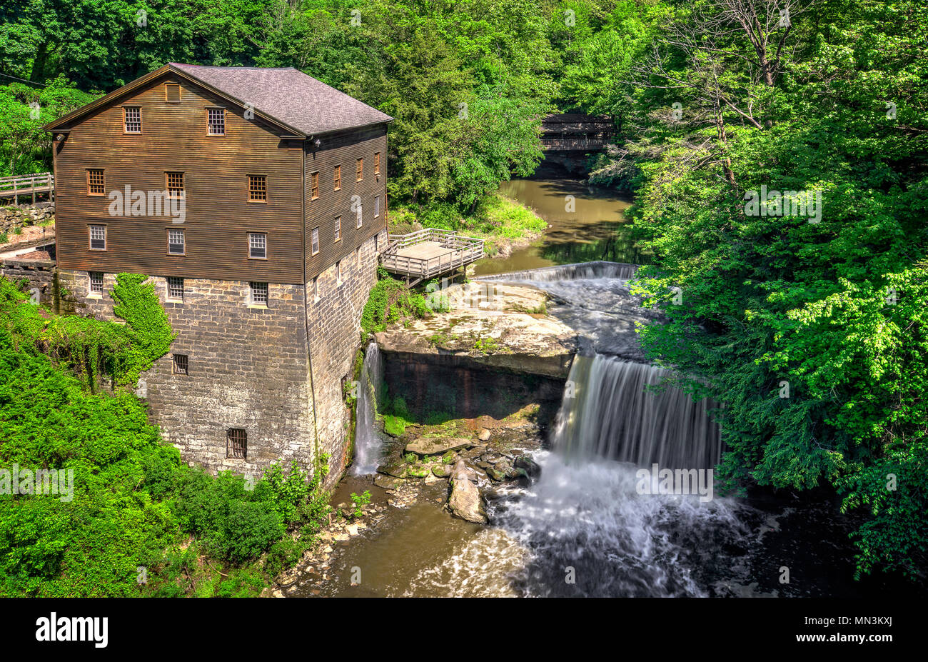 The historic Lanterman's Mill in Mill Creek Park in Youngstown Ohio. Built in 1845 and restored in 1982-1985. The mill still operates today. - Stock Image
