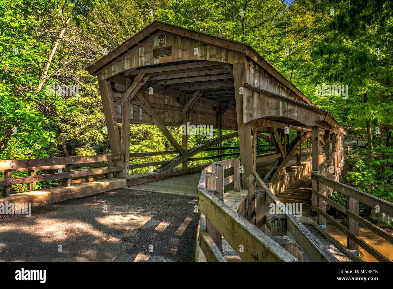 The covered bridge at Lanterman's Mill in Mill Creek Park in Youngstown Ohio. Built in 1989. - Stock Image